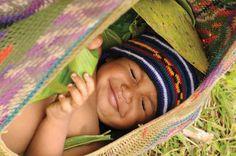 A 'Huli' baby snug in his 'bilum' bag cradle & 'bilum' hat... having a wonderful dream by the looks of it! #PapuaNewGuinea