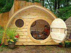 Hobbit Hole Playhouse with round front door and windows, cedar roof, cedar clapboard siding, all natural wood construction - This would be amazing to have in the backyard! Cubby Houses, Play Houses, Hobbit Hole, The Hobbit, Build A Playhouse, Playhouse Ideas, Hobbit Playhouse, Backyard Playhouse, Outdoor Playhouses