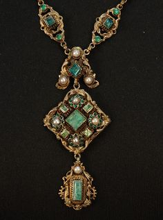 AUSTRO-HUNGARIAN JEWELED NECKLACE, c. 1890. Renaissance Revival style, in silver gilt with emeralds and pearls having triple pendant drops suspended from twenty- two jeweled links.
