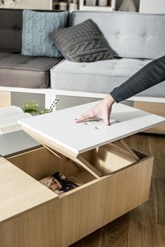 This Coffee table has lift-up top board in one of its quadrants. During assembly process you can decide which side of table top will be lifted – there are two options: lift up above the same quandrant, or out beyond the table area.