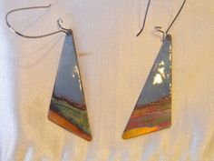 These earrings are made using delft blue enamel and the technique of flame painting the copper on the bottom. They are a triangle shape that is about 1 long. All ear wires are nickle and lead free. I can custom make these for you in any color enamel. Copper Earrings, Copper Jewelry, Turquoise Jewelry, Jewelry Ideas, Diy Jewelry, Jewlery, Jewelry Design, Thing 1, Triangle Earrings