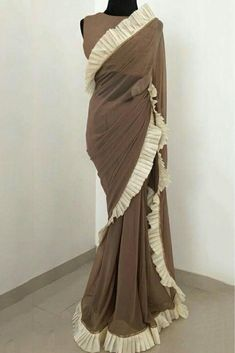 The Stylish And Elegant Ruffle Saree In Brown Colour Looks Stunning And Gorgeous With Trendy And Fashionable Georgette Cotton Fabric Looks Extremely Attractive And Can Add Charm To Any Occasion. Drape Sarees, Saree Draping Styles, Saree Styles, Simple Gowns, Simple Sarees, Indian Fashion Dresses, Indian Outfits, Fashion Illustration Dresses, Sari Dress