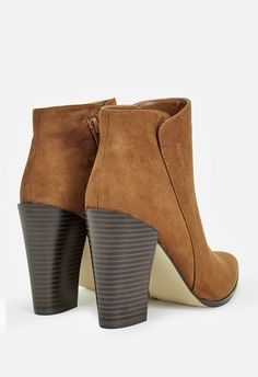 Rev up your boot game with a retro style like this faux suede bootie. A pointed toe and block heel make this look a groovy one!  ...