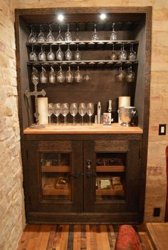 The Wine Tasting Room includes a Glass Display Rack and Humidor. This wine cellar is actually one of the most interesting wine cellar projects we did for a client in Naples, Florida. Check out more photos and video here - http://www.winecellarspec.com/remarkable-custom-wine-cellars-naples-florida-with-a-wine-tasting-room/.