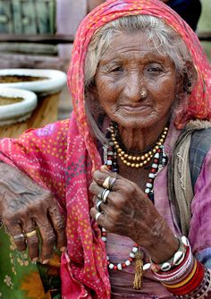 India | One of the older gypsies living around Pushkar. She comes into town with her cobra to make a bit of money from time to time | © John Paskey