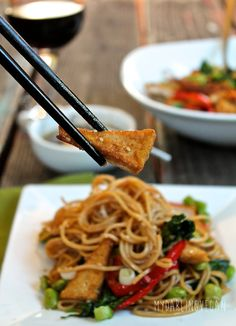 This udon noodle tofu stir fry with sweet ginger sauce is a hearty and delicious vegan meal that the whole family will love.