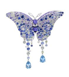 Broche papillon en saphir, aiguemarine et diamants