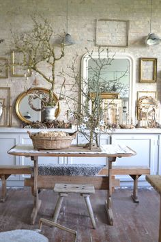 Simply Stunning, from the white-washed flooring, to the white accenting against cream, to the delicate trees, bright and charming.