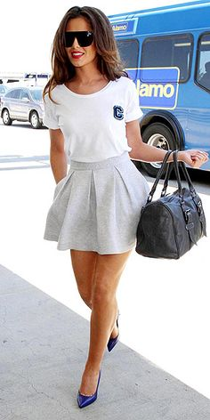 "CHERYL COLE  Sweats: no longer just for sick days and sleeping. At least not when the fabric is in the form of a pleated skirt. The British starlet tops her gray Markus Lupfer mini with a ""C"" tee (also by the designer) and bright blue Saint Laurent pumps. Which makes this the first time sweats have ever been worn with monograms and designer heels."