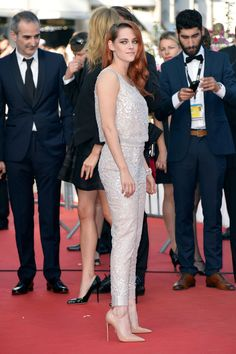 """Kristen Stewart at the """"Clouds of Sils Maria"""" Premiere during the Annual Cannes Film Festival on May She's wearing a Chanel Haute Couture jumpsuit.nude Christian Louboutin """"So Kate"""" pumps and a diamond Chanel Fine Jewelry 1932 Plume bracelet. Kirsten Stewart Style, Kristen Stewart Cannes, Cannes Film Festival 2014, Sils Maria, Vogue, Dressed To The Nines, Red Carpet Dresses, Celebs, Celebrities"""