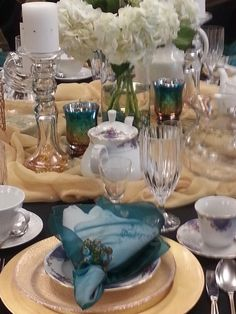 Our women's tea . My hostess table. Love the colors of teal, gold that I chose.