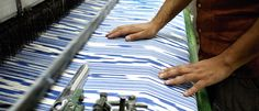 The making of a traditional Majorcan #ikat fabric: In the loom, the threads are woven plain-weave, using natural linen as the weft.