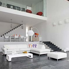 Loving the split level white dining room and white living room. Maybe more textural differentiation using rugs, vases, cushions, throws, wall hangings.