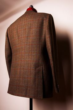 A gentleman's sport coat made of Glen Royal fabric from Porter & Harding - with a herringbone ground and over-check.