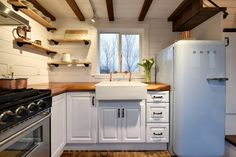 A rustic 24' tiny house from Mint Tiny House Company. Love the vintage fridge!!
