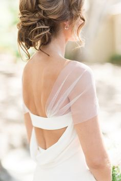 Sheer off-the-shoulder draping Vera Wang wedding dress: http://www.stylemepretty.com/2016/12/15/best-wedding-dresses-of-2016/ Photography: Carlie Statsky - http://www.carliestatsky.com/