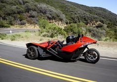 Polaris' Slingshot can sit two people side by side, unlike traditional trikes.