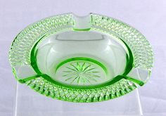 "Ashtray Vintage Depression Vaseline Green Glass Round Small Diamond Pattern    Depression Glass ashtrays are becoming ""scarce as hens' teeth"", and so I was quite pleased when I found this one in one of my favorite antique malls.  Just waiting for me.     This 80 to 90 year old ashtray is a design that I have not seen before.  The ashtray is in a small round shape and on the rim is a diamond pattern.      The glass is uranium green vaseline and under a black light gives off a warm green glow…"