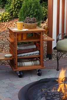 Side table for the patio--would be cute with towels and blankets for the pool and for cool nights outside