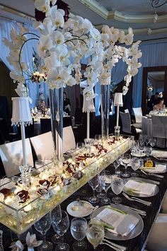 White Orchid Table scape.. Absolutely Gorgeous.
