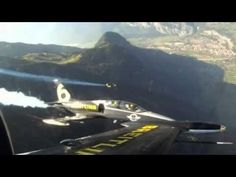 Man in Jetpack Races Real Jet Aircrafts! Swiss pilot Yves Rossy flies a spectacular formation flight alongside two Albatross jets over the Swiss Alps.