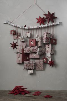 How to make your own Advent calendar this Christmas. Wrap the gifts in beautiful paper and hang them from a wooden stick, simple and elegant. Find Christmas wrapping paper, tags, decorations and more DIY inspiration on our website. Christmas Wrapping, Diy Christmas Gifts, Christmas Time, Christmas Decorations, Advent Calenders, Diy Advent Calendar, Christmas Activities, Xmas Ornaments, Scandinavian Christmas