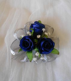 wrist corsage | Wrist corsage featuring a trio of silk royal blue roses with ...