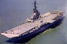 The U.S. Navy aircraft carrier USS Essex (CVA-9) underway. The Essex with assigned Carrier Air Group 11 (CVG-11) was deployed to the Western Pacific from 16 July 1956 to 26 January 1957. Pictured here after the SCB-125 modernization 1956.