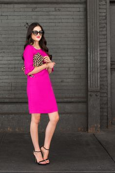 This pretty dress has a simple cut with gorgeous flirty sleeves. The Claire Vivier leopard print clutch adds a touch of pattern and totally grounds the fuchsia colour….And look at  those killer sexy mama heels!