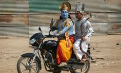 Indian men dressed as Hindu God Rama, front, and Arjun sit on a motorcycle as they participate in a religious procession to mark the Ram Navami festival in New Delhi. The festival celebrates the birthday of Hindu god Rama. Festivals Of India, Indian Festivals, Om Art, Travel Attire, Quirky Quotes, Indian Man, Pink Moon, Image Of The Day, Vintage Bikes