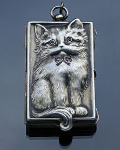 Sterling silver cat locket (Germany, c. 1900)