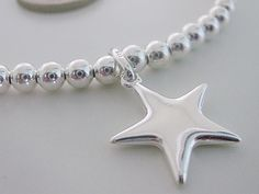 Womans Stretch Silver Ball Charm Bracelet 925 Sterling Silver Beads, Puff Star Charm,Stacking, gift for her, bridesmaid gift, gift for women by funksionjewellery on Etsy