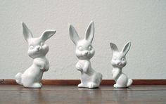3 white porcelain rabbits