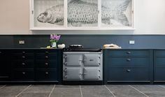 There's no danger of the grey in this kitchen looking dull thanks to the gorgeous vibrancy of the navy blue cabinetry. The hand-painted fish in the cabinet above the AGA adds a stunning quirky look. This AGA is an Series 100 model in Pearl Ashes. Industrial Kitchen Design, Kitchen Interior, Beautiful Kitchen Designs, Beautiful Kitchens, Aga Kitchen, Kitchen Ideas, Kitchen Trends, Grey Kitchen Inspiration, English Country Kitchens