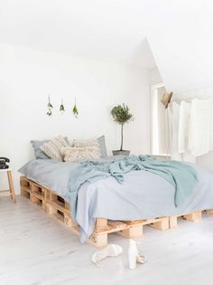 light, airy bedroom with a pallet bed frame