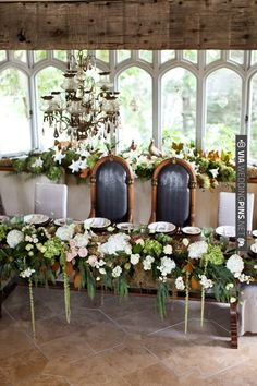 Love the flowers! Bride and groom table, photo by | VIA #WEDDINGPINS.NET
