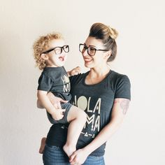 Seriously these two brighten up my day! @mamabunch + her lil man in our Hola Mama dark grey tee. Love! | Shop www.stellar-seven.com | #stellarseven #mommyandme #twins #holamama #mama #momandson #ig_kids #instagram_kids #kids #instafamily #family #instababy #shopsmall