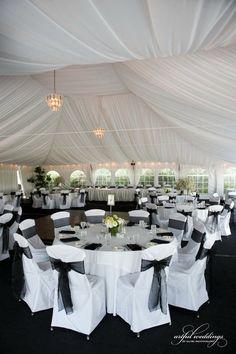 #chaircovers #sashes #wedding #chiffon #reception #chandelier #maryland
