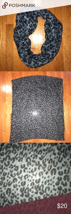 NEVER WORN blue and black cheetah scarf Blue and black cheetah scarf. Got as a gift never worn. Very soft Accessories Scarves & Wraps