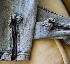Jeans with zippers and bows at the ankle