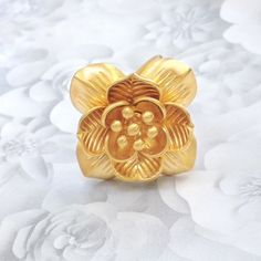 """Satya Lotus Flower New Beginnings Ring in Gold Lovely lotus!! Gorgeous statement ring with 3D lotus flower design. 18K gold plated over brass. Size 8, adjustable. Flower is approx 1"""" wide square, 3/8"""" height, with 6mm curved band, weight 12.3 grams. Stamped Satya TM on inside band. Like new, excellent condition. Listing includes one ring. Sweet on its own or in addition to your stacks. Beautiful & chic! Satya Jewelry Jewelry Rings"""
