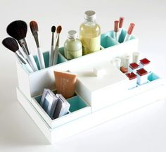 Fill a metal or plastic desktop organizer with makeup, brushes, pencils, and other beauty essentials. Store the entire organizer under the sink when not in use.