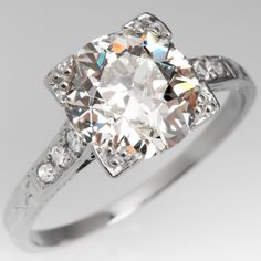 This amazing Art Deco engagement ring features a carat old European cut center diamond with a gorgeous open sparkle. The ring features lovely engravings and detail work and is crafted in white gold. Antique Wedding Rings, Antique Diamond Rings, Antique Engagement Rings, Vintage Diamond, Best Engagement Rings, Deco Engagement Ring, Art Nouveau, Art Deco Jewelry, Vintage Jewelry