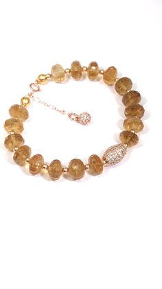 gemstone bracelet with pave cz rose gold. Faceted rich, deep, golden citrine rondelles mix with rose gold pave cz beads in the stunning bracelet.Faceted rich, deep, golden citrine rondelles mix with rose gold pave cz beads in the stunning bracelet. Gold Bangles, Gold Earrings, Statement Earrings, Flower Earrings, Beaded Earrings, Bracelet Rose Gold, Bracelet Making, Jewelry Making, Diy Bracelet