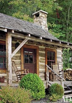 A rustic log cabin compound in the foothills of the Great Smoky Mountains, designed by Suzanne Kasler | archdigest.com
