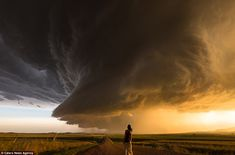 Megacell: Wyoming-based Daow Wegner is snapped gazing off at a brewing storm
