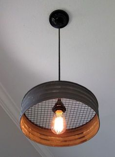 Metal Sifter Pendant Light What a great light! Made with a grey corrugated metal that looks just like it came from an old farmhouse. This would make a great addition to a kitchen, laundry room, mudroom, barn, etc. The diameter Rustic Kitchen Lighting, Industrial Ceiling Lights, Kitchen Lighting Fixtures, Farmhouse Lighting, Rustic Farmhouse, Kitchen Rustic, Kitchen Industrial, Farmhouse Style, Cheap Kitchen