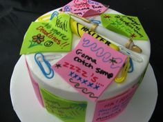 BC icing, fondant post-its, hi-liter, pen and paper clips.  Wrote on post-its with edible food writers.  Painted gold on silver pen.  I mixed a little tylose into the fondant to make it dry quicker.  Dried the post-it notes on cake dummies, cake pans, and fondant  containter.