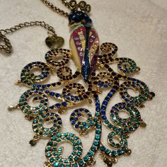 """BETSEY JOHNSON PEACOCK NECKLACE BETSEY JOHNSON PEACOCK NECKLACE  BLUE, PURPLE BIG PEACOCK STATEMENT NECKLACE. NECKLACE FEATURES SINGLE GOLDTONE PEACOCK WITH BLUE & PURPLE RHINESTONES ALL OVER. PENDANT : 5-1/2"""" & CHAIN MEASURES 30"""" WITH EXTRA 3""""ENTENDER. NWOT Betsey johnson  Jewelry Necklaces"""