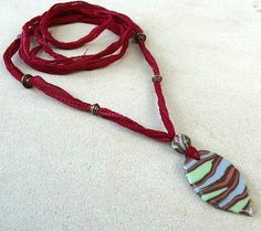 Handmade porcelain leaf pendant & bead on silk ribbon necklace. Ceramic